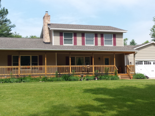 Front view of wrap around hand made wood decks in Clio, MI