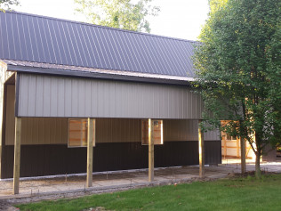 side view of newly constructed pole barns in Clio, MI