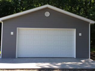 Outdoor, stand alone garages with newly constructed roofing in Clio, Mi