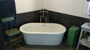 newly installed stand alone bathroom tub in remodeled bathroom from Clio, MI