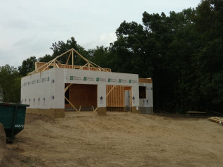 New house construction with the roof being built in Clio, MI